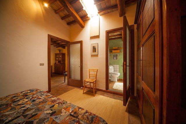 Camera da letto con salotto e bagno